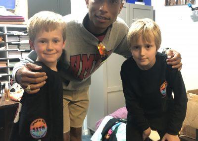 Stokes boys with Pharrell at Haygood Skating Center