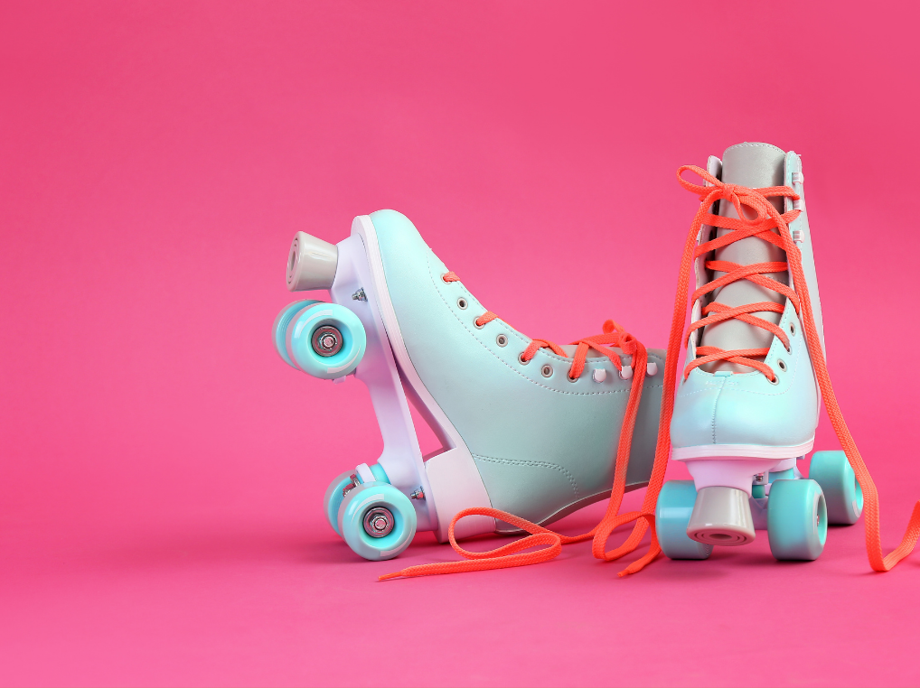 Two blue skates on a pink background