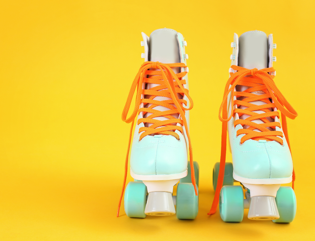 Two blue skates on a yellow background