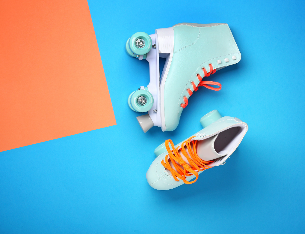 Two blue skates on an orange background
